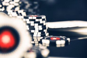 Piles Of Casino Poker Chips On Table.