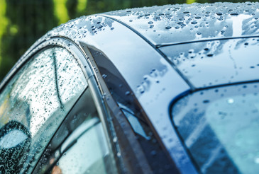 Wet Blue Car Body with Water Drops