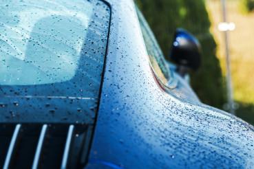 Wet Clean Modern Car Body Close Up