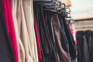 Woman Clothes Hanging on a Store Rack