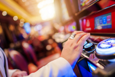 Woman in Her 40s Playing Modern Slot Machine
