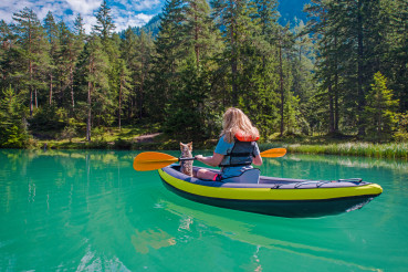 Woman Kayaking with Her Dog on Scenic Turquoise Lake