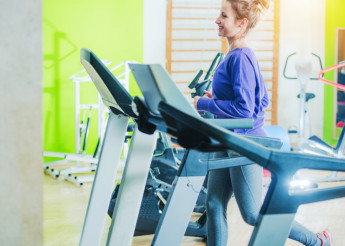 Woman on Fitness Treadmill