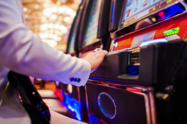 Woman Playing Slot Machine