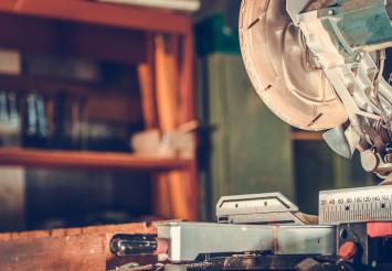 Close Up Of Chop Saw In Carpenter Workshop.