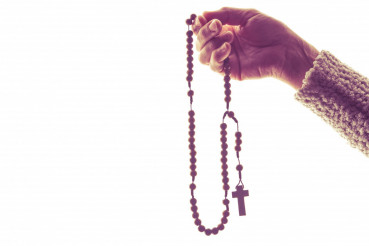 Wooden Rosary in Hand