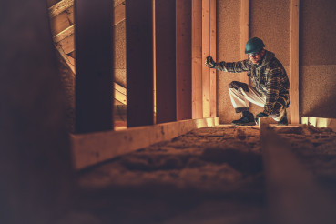 Worker and His Wooden Attic Job