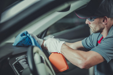 Worker Cleaning Car Interior