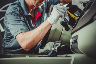 Worker Detailing Car Interior