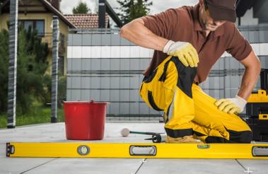 Worker Finishing Patio Bricks Pavement