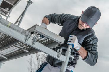 Worker Installing Scaffolding