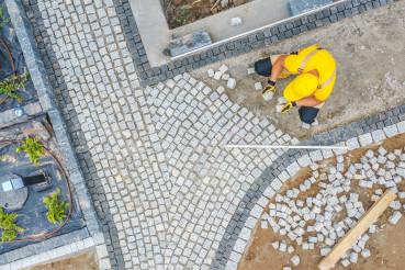 Worker Paving Garden Path Aerial Vista