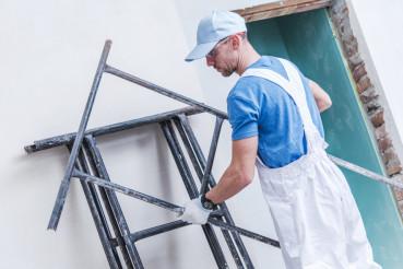 Worker Preparing Scaffolding
