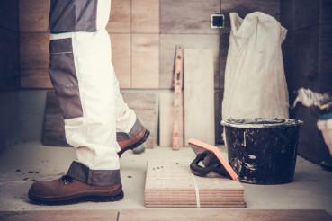 Worker Remodeling Bathroom