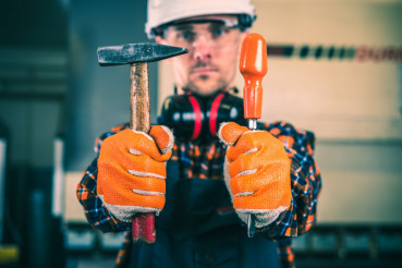 Worker with Essential Tools