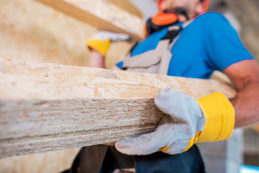 Worker with Wooden Materials