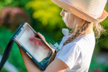 Young Girl with Tablet Device