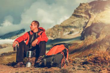Male Hiker Resting After Walking Long Distance.