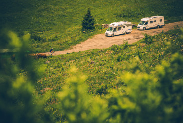 Mobilehome Campers Parked On Rural Road.