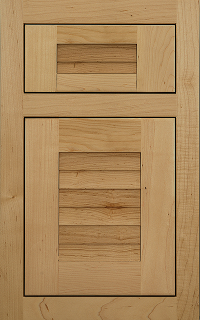 Antigua Inset Maple cabinet door finished in Natural with a Classic Drawer Front Option - Product line id was not supplied.