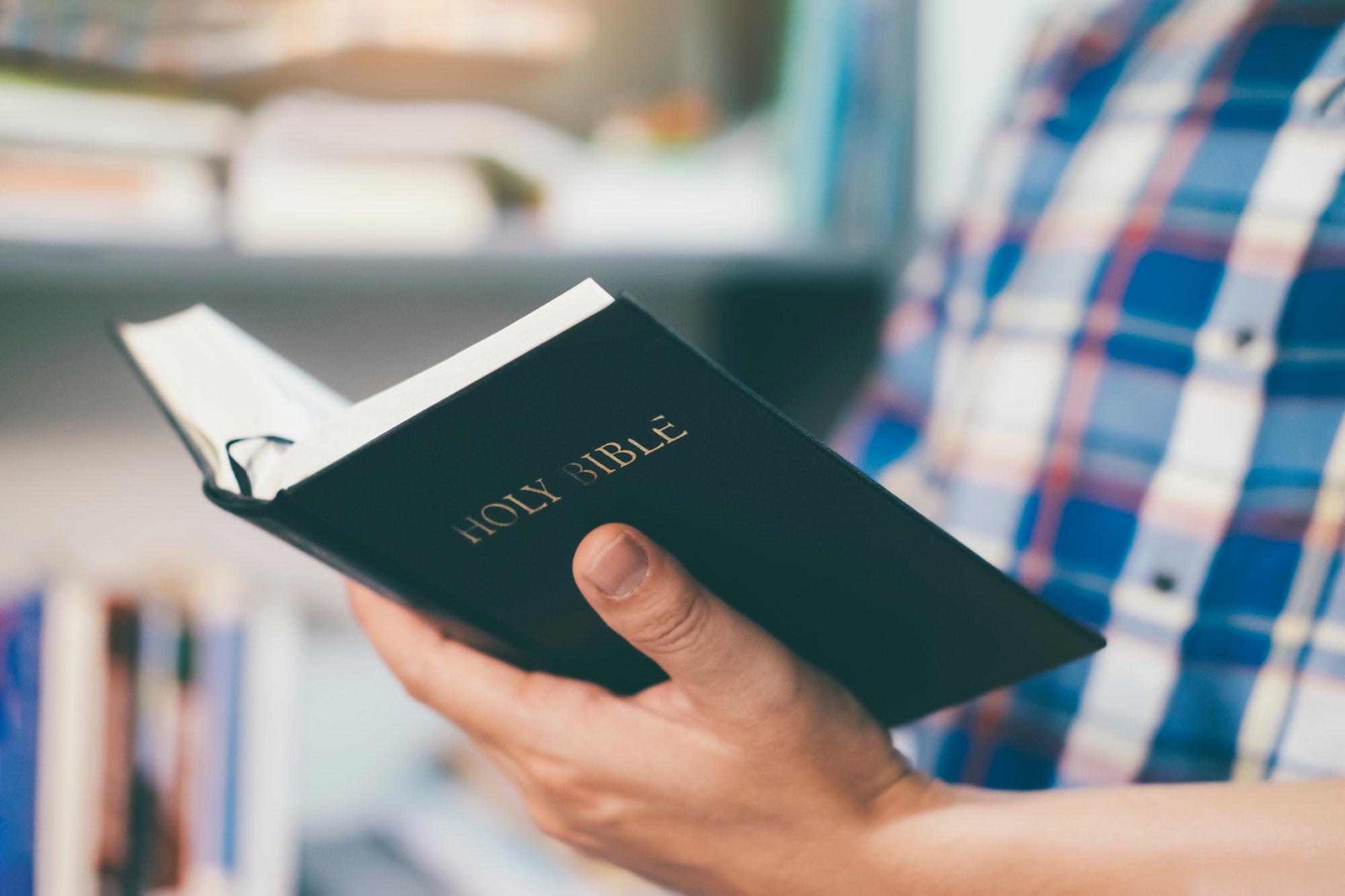 Man reading holy bible.