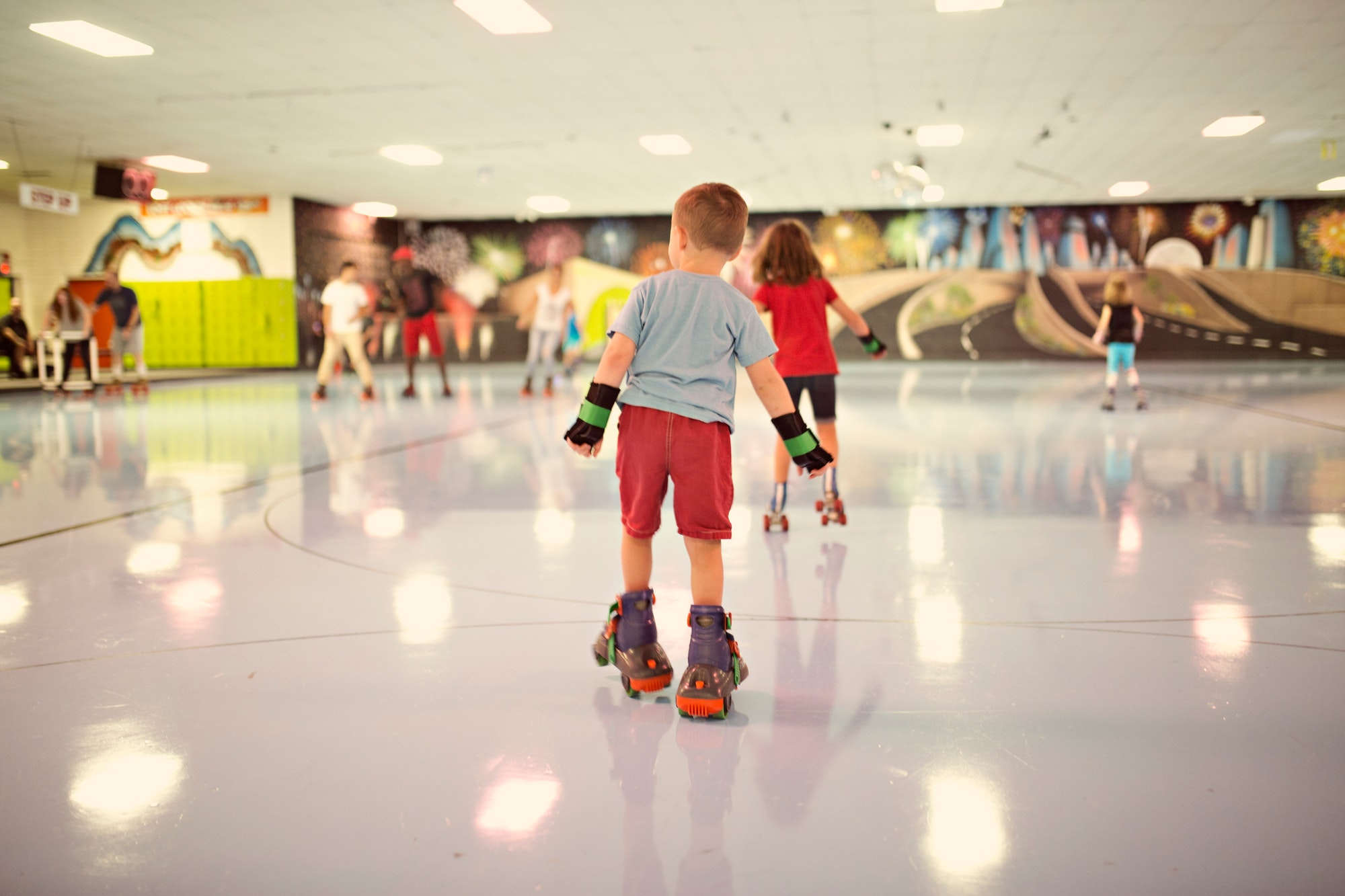 Family roller skating at a roller rink