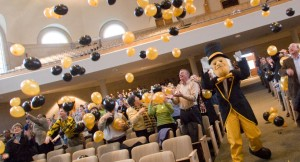 Students and the Deacon celebrating inside Wait Chapel with black and gold balloons