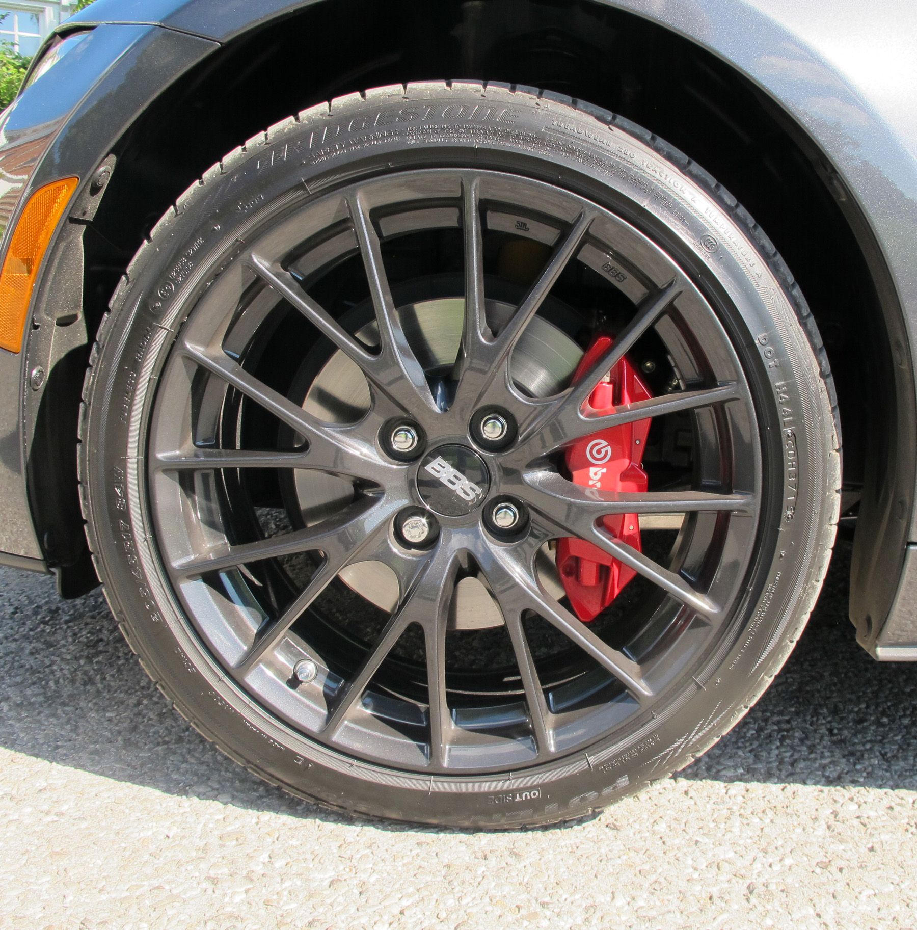 The GS model with Sport Package includes 17-inch BBS forged alloy wheels (dark finish), dark finish Brembo front brakes and red painted front and rear brake calipers.
