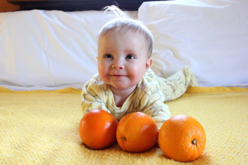 Laid around with some oranges... I don't know ask mommy. I don't get it either.