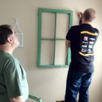 Carrie's dad and I hung up some decorative window frames in Fia's room. Eventually there will be constellations in them.