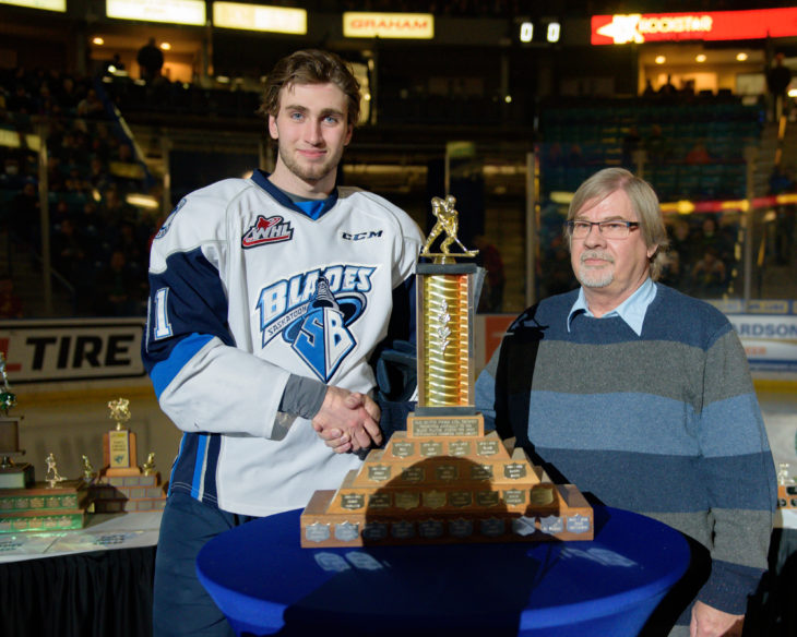 Barry Randall of Old Dutch presents the Most Gentlemanly Award to Blades forward Josh Paterson