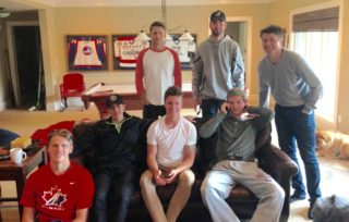 Hudson, bottom-right, with family and friends on draft day. Chiefs captain Tyson Helgesen is seated at bottom-left.