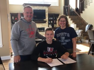 Larson with his parents.