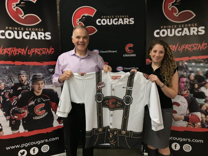 Cougars' Vice President, Andy Beesley & PGCF Director of Development, Mindy Stroet with the Oktoberfest jersey.