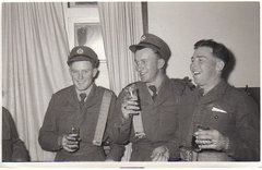 my dad on left in Malaya having a much needed beer