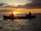 Canoeists paddle quickly to make it to their campsite before the sun sets in the 10,000 Islands.