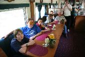 Participants gather in a dining car on the train to Copper Canyon.