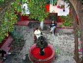 Two participants enjoy coffee in the morning in the hotel courtyard in Batopilas.