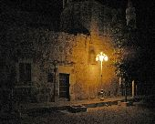 An old street light glows next to a brick wall in El Fuerte, the gateway to Copper Canyon.