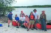 Group poses with the canoes on Pumpkin Key.