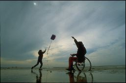 Two participants try to get their kite to take flight at dusk in the Florida Keys.