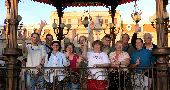 The Wilderness Inquiry group waves from a pavillion in the plaza of Chihuahua Mexico.