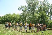 Participants circle up to take part in a safety talk before a Mississippi River Day trip.