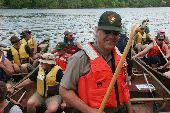 NPS Ranger Dave Wiggins prepares to set off on the river with a group of canoes.