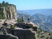 Two participants balance on rocks on top of Copper Canyon.