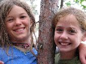 Young girls next to a young red pine in the Apostle Islands