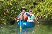 Tom and Ned navigate their canoe out of the intricate mangroves in the Florida Keys.