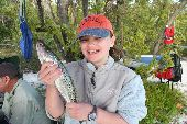 Young Abby holds up her freshly caught sea trout in the Florida Everglades.