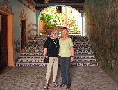Two female participants stand in a decorative archway at a hotel in Copper Canyon.