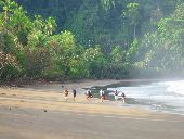 Participants hike along the beach of Costa Rica's Osa Peninsula